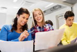 education, high school and people concept - happy student girls with tests at lecture hall - 234467017