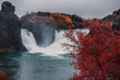 Majestic waterfall Hjalparfoss in Iceland in autumn in cloudy weather