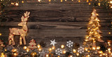 Christmas background with wooden decorations and candles. - 234488280