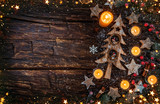Christmas background with wooden decorations and candles. - 234488472