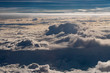 beautiful fluffy clouds from the window of the plane - 234492444