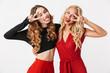 Leinwanddruck Bild - Two pretty young smart dressed girls wearing makeup