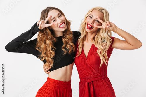Leinwanddruck Bild Two pretty young smart dressed girls wearing makeup