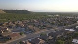 Aerial of a suburban neighborhood and a communications tower - 234498254