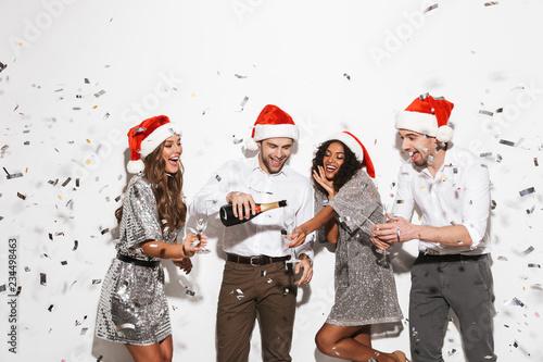 Leinwandbild Motiv Group of four cheerful smartly dressed friends