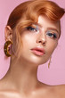 Beautiful girl with unusual accessories and make-up on a bright background. Beauty face. - 234504230
