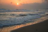 Sunrise at sea. Sunny path and waves. Georgioupolis beach, Crete Greece