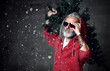 Leinwanddruck Bild - Fashionable modern Santa old man in red fashion hoodie and sunglasses Merry Christmas