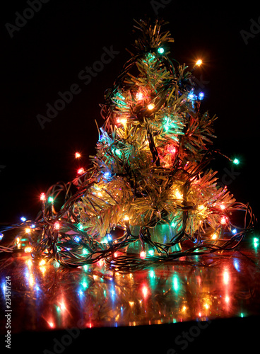 Blurred electric lights on black background - 234517214