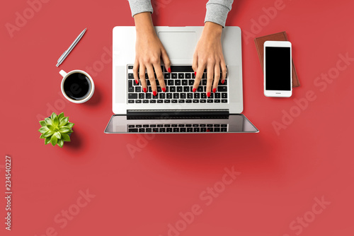 Leinwandbild Motiv Woman working in modern office. Top view