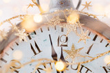 vintage alarm clock is showing midnight. It is twelve o'clock, christmas and bokeh, holiday happy new year festive concept on light bokeh background - 234565857