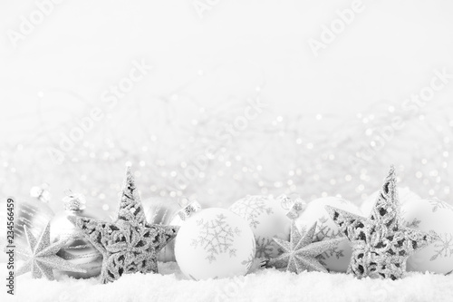Christmas greeting card. Festive decoration on bokex silver background. New Year concept. Copy space.  Flat lay. Top view. - 234566459
