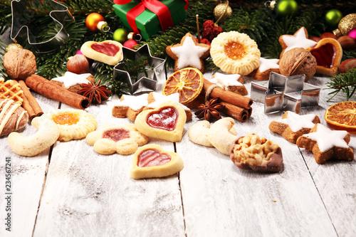 Leinwandbild Motiv Baking christmas cookies. Typical cinnamon stars bakery for xmas with ingredients.
