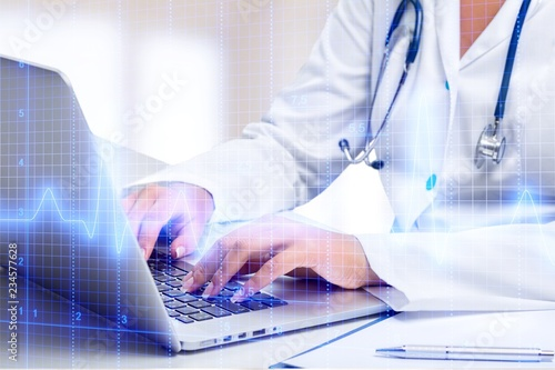 Close-up Doctor at hospital working with laptop © BillionPhotos.com