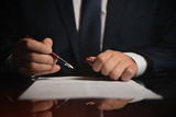 Lawyer, attorney signing a contract - 234581047