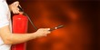 Man using fire extinguisher against grey background