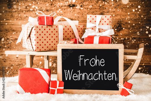 Leinwanddruck Bild Sled With Many Gifts, Calligraphy Frohe Weihnachten Means Merry Christmas