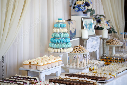 Delicious candy bar with cucakes, cookies and other sweets