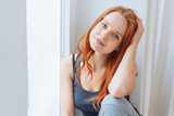 Thoughtful young blue-eyed woman - 234634832
