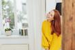 Leinwandbild Motiv Relaxed happy young redhead woman indoors