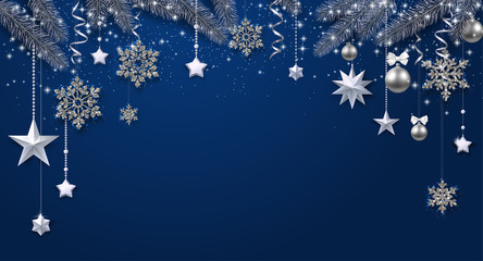 Blue shiny festive background with fir branches and Christmas decorations.