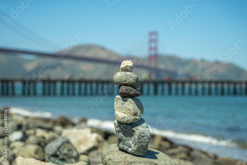 Stacked stones with the golden gate bridge background, san francisco