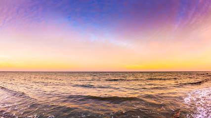 Sunset at the ocean as a background © John Smith