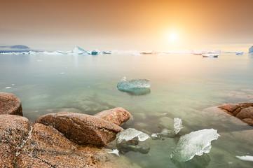Icebergs on the shore of Atlantic ocean, Saqqaq village, western Greenland
