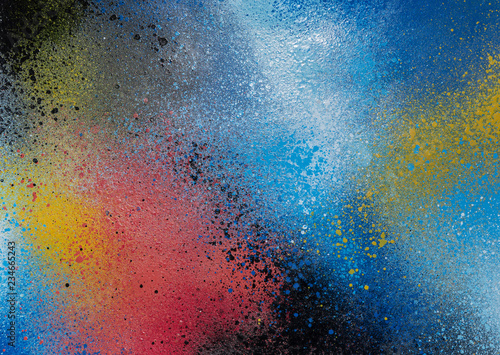 Full frame photo of a colorful and splattered spray paint background. - 234665243