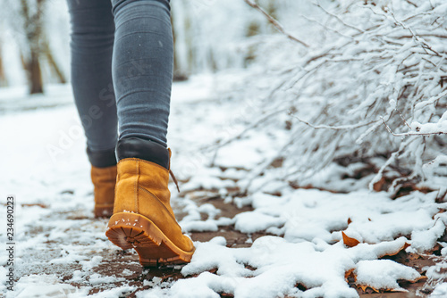 woman winter boots on snow close up