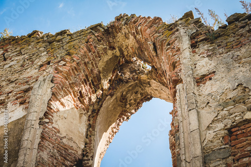 An arch in the ruined wall of the medieval castle_