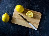 fresh lemon on a wooden cutting board