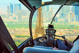 Helicopter cockpit flying on Paris Tour Eiffel tower skyline. Scenic flight over Paris skyline.