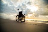 sunset childlike wheelchair horizon sand - 234722438