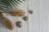 Close up two wooden soft massage brushes for body and legs. With copy space for text. Concept of cosmetology, weight loss, spa, beauty, cellulite.