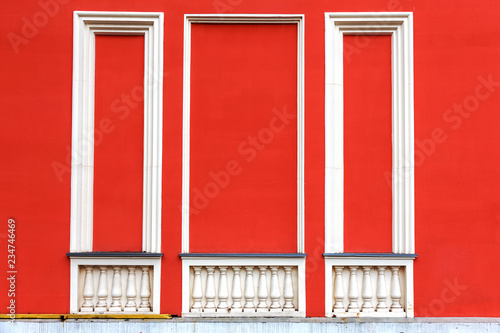 Rectangular plaster decorative frames on the wall, balustrade, columns, balusters as a decorative ornament on the wall. Empty background of a plastered brick painted wall with decorative arches. © Aleksandr Lesik