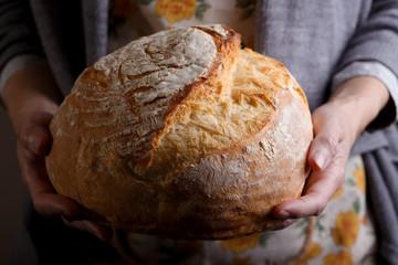 girl holding fresh white bread