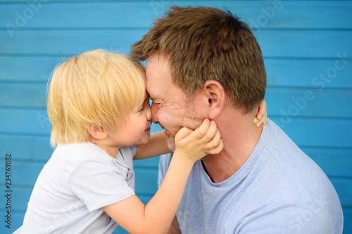 Leinwandbild Motiv Little baby embrace his father.