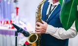 performance of a saxophonist musician at the New Year's holiday, wedding.