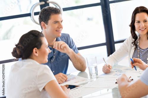 Leinwandbild Motiv Image of business partners discussing documents and ideas