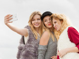 Three women taking selfie outdoor