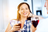 Woman with holding a glass of wine indoors - 234801223