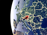 Night view of Austria from space with visible city lights. Very detailed plastic planet surface. - 234833483
