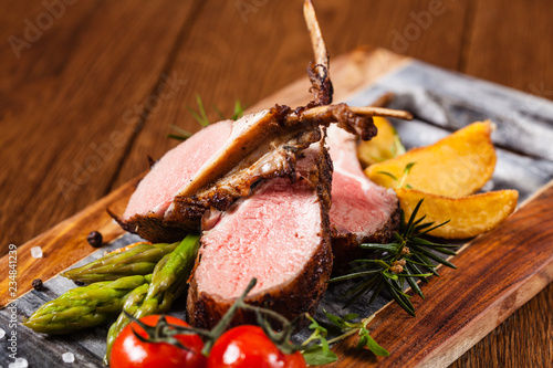 Baked lamb loin, served with asparagus. - 234841239