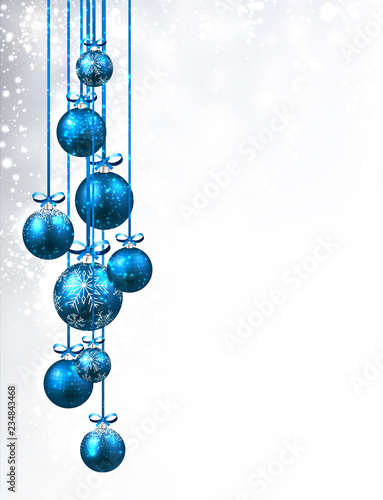 Christmas and New Year shiny card with blue Christmas balls and snow.