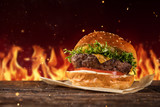 Delicious hamburger with fire on background - 234844001