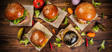 Delicious hamburgers, served on wood. - 234844243