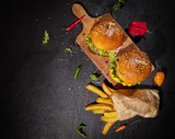 Delicious hamburgers, served on stone. - 234844433