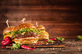 Delicious hamburger with fries, served on wood - 234844492