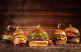 Delicious hamburgers, served on wood - 234844829